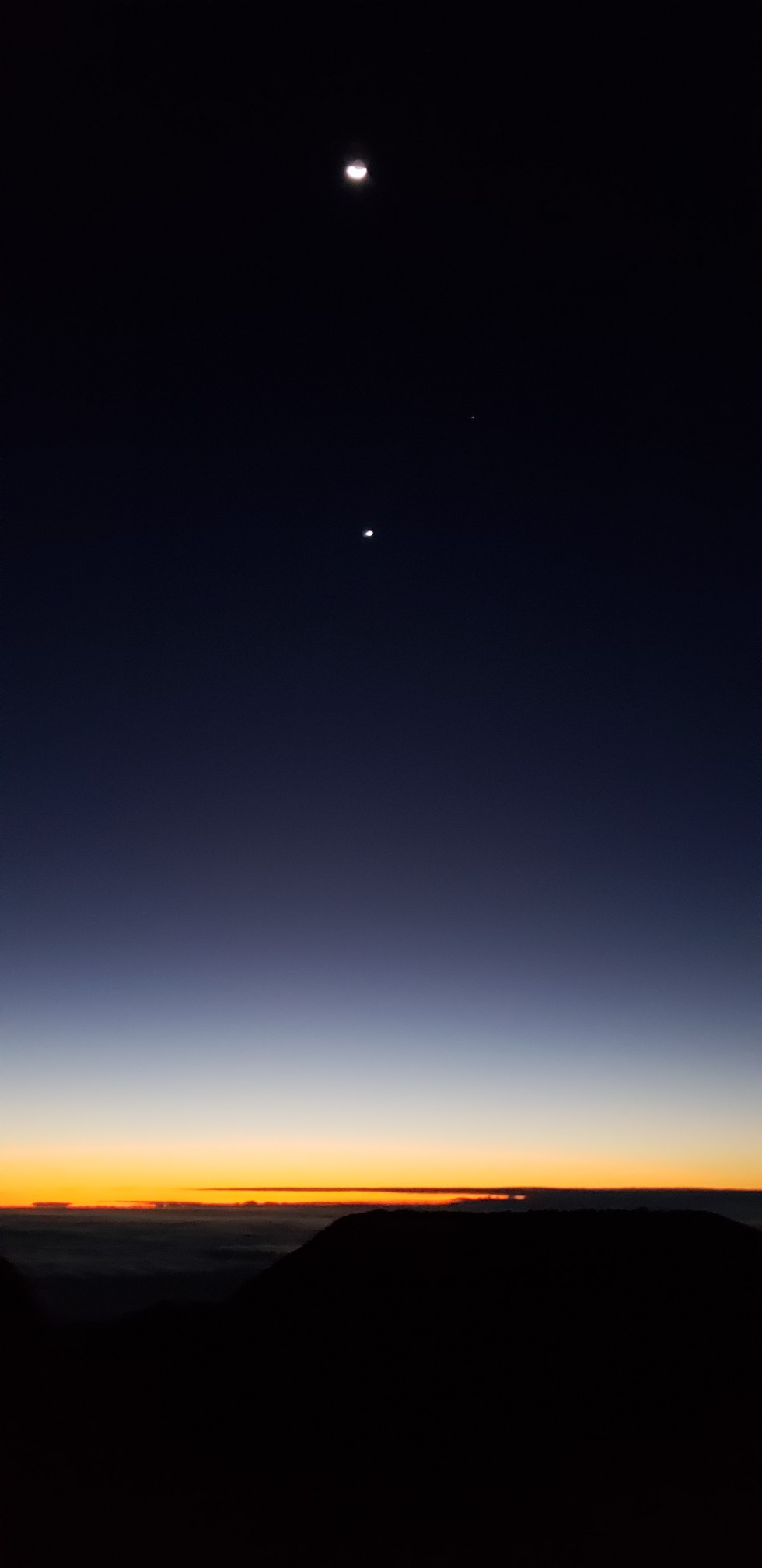 Pre-dawn glow, with the Moon and Jupiter above Haleakala Crater, December 2, 2018 (Image Copyright 2018 Holly Jahangiri)